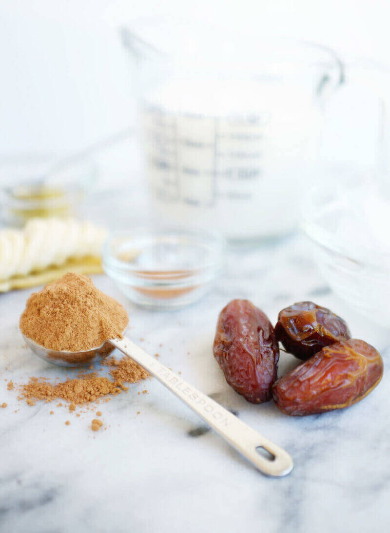 Ingredients for Cacao Smoothie: almond milk, honey, banana, dates, ice, cinnamon and raw cacao