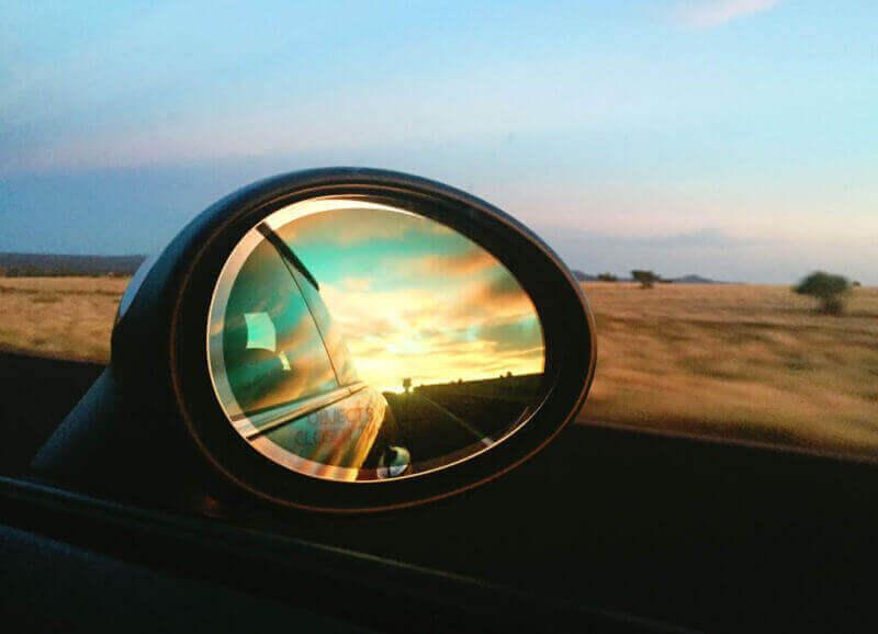 Desert sunset in the rearview mirror