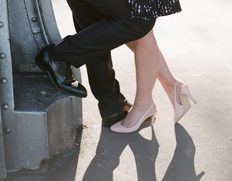 Lovers feet under the Bir Hakeim bridge