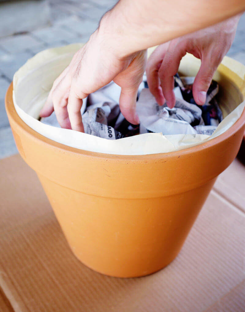 She's So Bright - Adding newspaper to the inside of the terracotta pot.