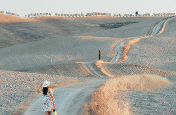 She's So Bright - An Italian Escape, Short Story. Views from Val D'orcia in Italy's Tuscany. Fields of wheat. Travel goals. International Adventure.