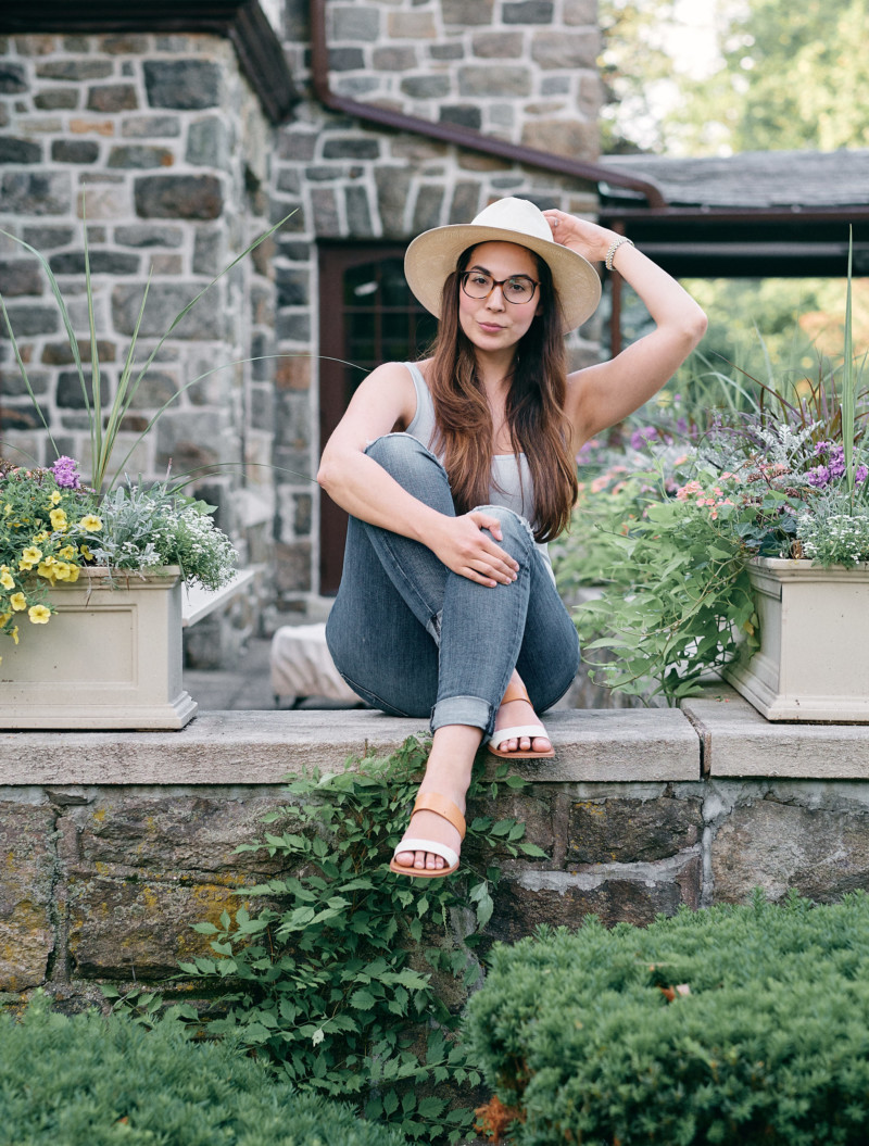 She's So Bright - Four-Eyed Thoughts for the Weekend. Sitting outside, patio, planters, stone, tudor house, style, hats.